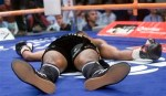 Joachim Alcine, of Canada, lies on the canvas after a sixth round knockout by Daniel Santos, of Puerto Rico, during their WBA light middleweight title fight Friday, July 11, 2008, in Montreal. (AP Photo/The Canadian Press, Ryan Remiorz)